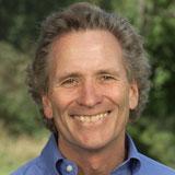Intrepid traveler Doug McConnell speaks at Little House on Aug. 20