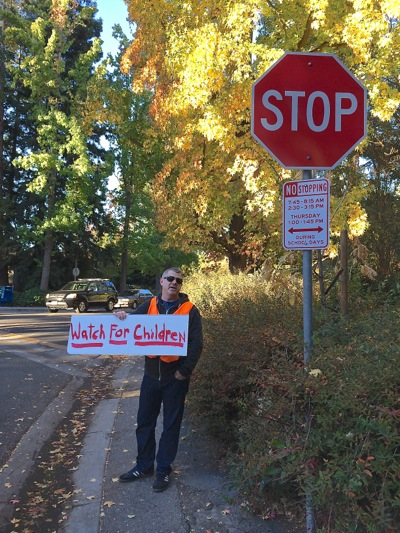 Post image for Traffic safety intervention staged by Oak Knoll school parents, reminding drivers to slow down