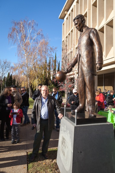 Menlo Park artist with statue he sculpted of Nikola Tesla