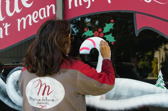 Spotted: Melissa deSigns painting Trader Joe's store windows for the holidays