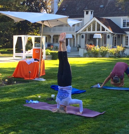 Post image for Julie Brody practices yoga at the 6th annual Ride and Yoga for Ravenswood