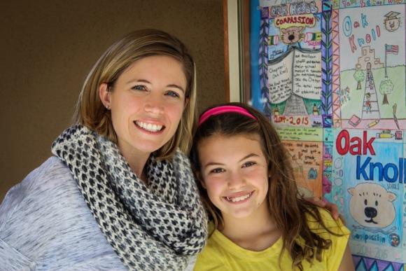 Master Chef Junior participant Mia Wurster celebrates with Oak Knoll Co-Principal Kristen Gracia