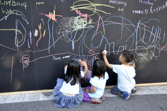 Three kids on Chalk board