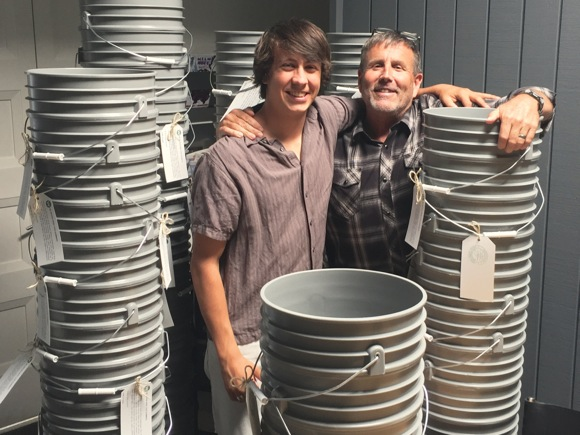 Keith Willig hands out five-gallon buckets to clients to promote water conservation