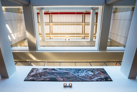 Looking up from lobby with SLAC site plan at bottom