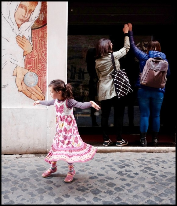 Wandering the cobblestone streets of Rome with camera in hand