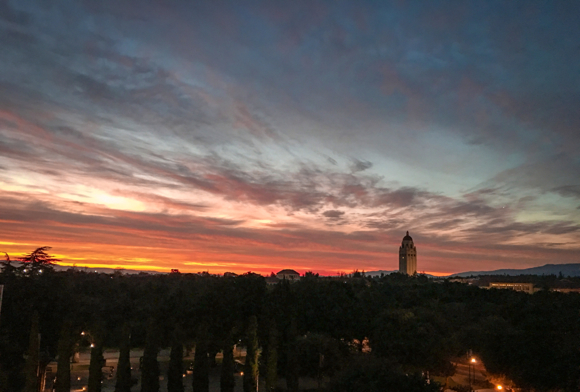 Spotted: Sun rising behind Hoover Tower