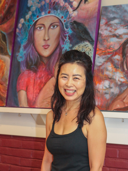 Asia in front of painting