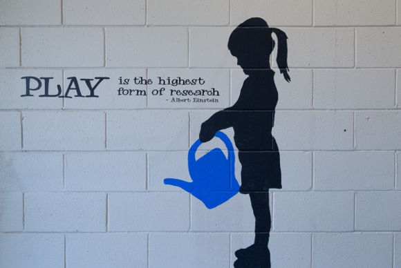 Play is the highest form of research - Alvert Einstein is painted on the wall at Alto International School in Menlo Park, CA.