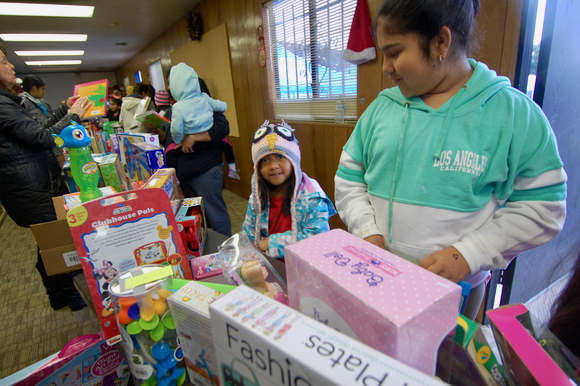 Happy kids get Christmas toys thanks to St. Anthony's Padua Dining Room