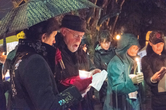 people participating in candlelight kindness vigil - 1