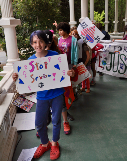 """Fourth graders at Peninsula School rally and march for """"peace, love and justice"""""""