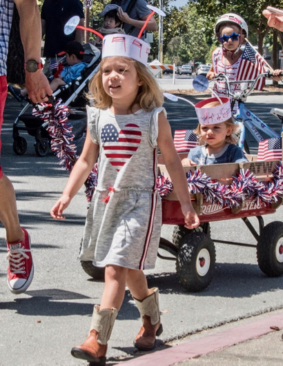 Youngsters get in the 4th of July spirit by parading in Menlo Park