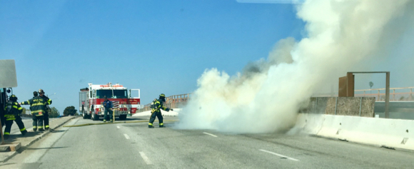Post image for Spotted: Firefighters at work extinguishing vehicle fire