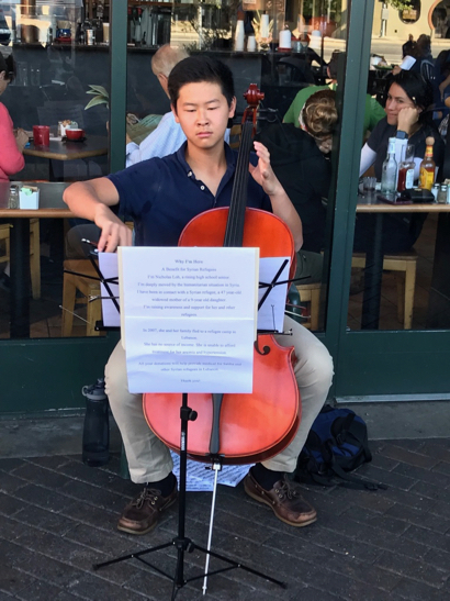 Post image for Spotted: Cellist playing at Cafe Borrone and raising money for refugees