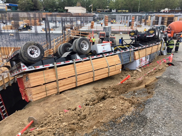 Lumber truck overturns at Station 1300 construction site in Menlo Park