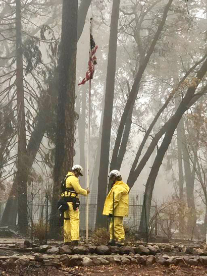 Post image for Members of Task Force 3 save American flag for owner outside destroyed Camp Fire home
