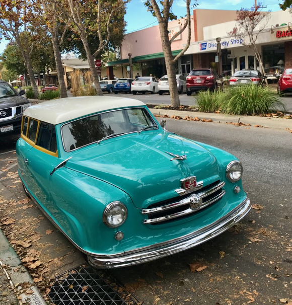 Who owns this beautiful turquoise blue Nash automobile?