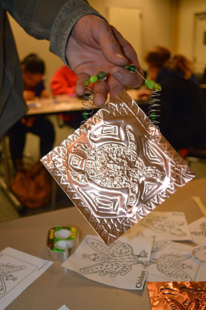 Adults create tin art at Belle Haven branch library on Dec. 1