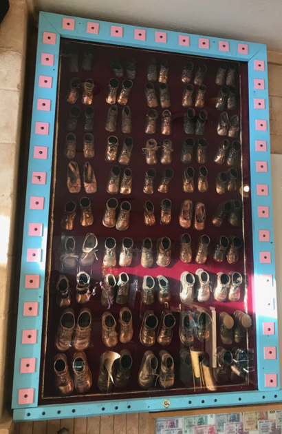 Spotted: Dozens of bronzed baby shoes at Buck's