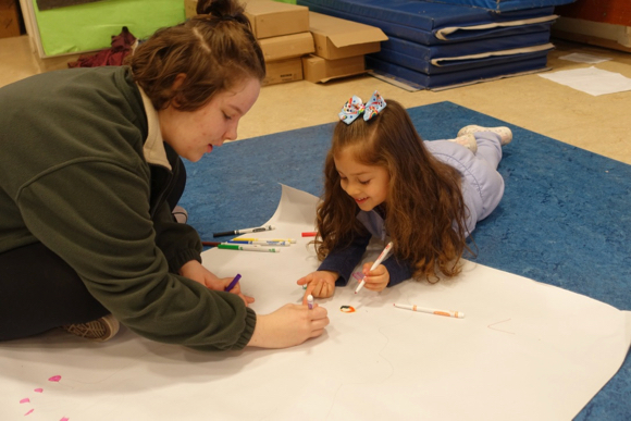 Hillview students team with preschoolers at the Early Learning Center on art projects