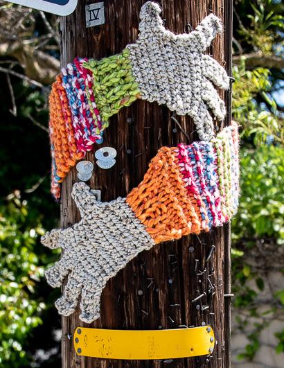 Menlo mystery: Yarn arms hugging telephone poles on Santa Cruz Avenue