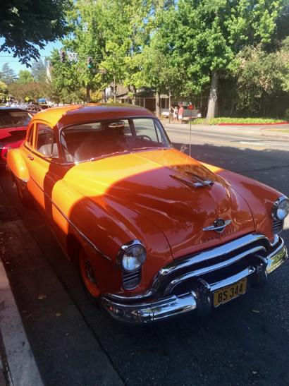 Take a look at this gorgeous orange Oldsmobile 88