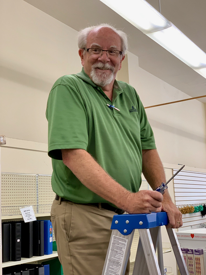 Kerry Hoctor is busy closing up shop at Village Stationery in Menlo Park