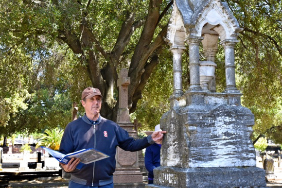 Bo Crane leads MPHA tour of Holy Cross Cemetery on October 12