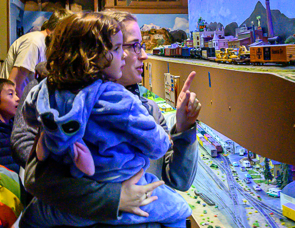 Pointing to the trains at the West Bay Model Railroad Association holiday open house