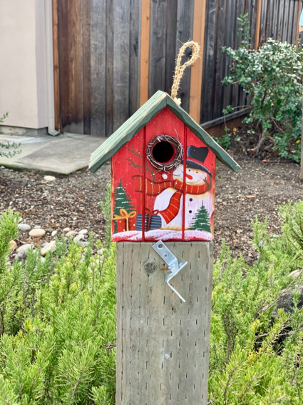 Spotted: Colorful holiday birdhouses awaiting occupants