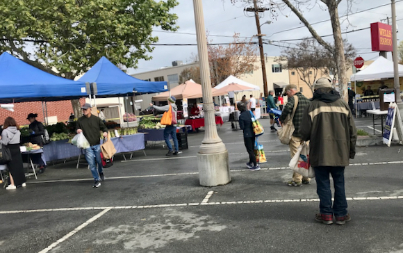 Shoppers obey new rules set in place this Sunday at Menlo Park Farmers Market