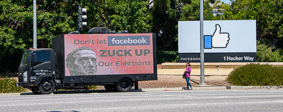 Mobile billboards take protest messages to Facebook and local company executives