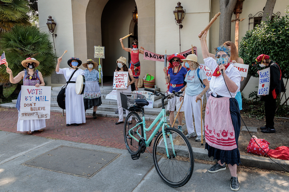 Raging Grannies form a line of defense in support of the post office