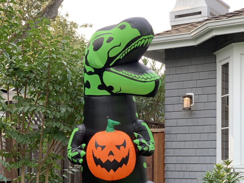 Spotted: Inflatable T-Rex with a pumpkin