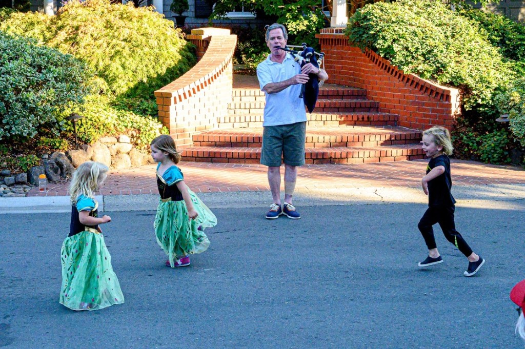 Ken Sutherland cheers his Menlo Park neighborhood by playing the bagpipes