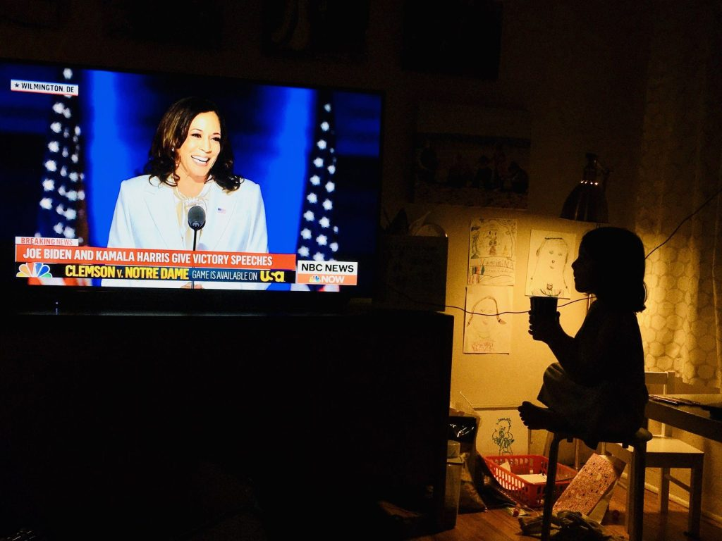 Spotted: Five year old girl watching Vice President elect Harris