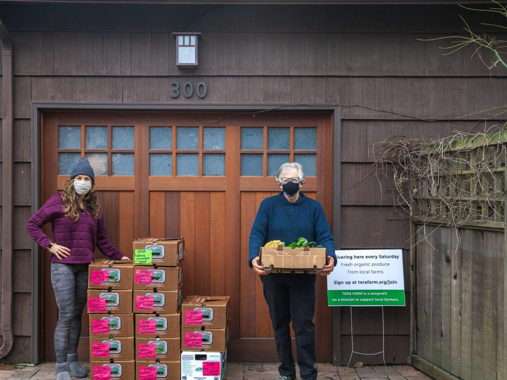 Local residents help small farmers by hosting organic produce drop off site