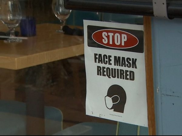 Locals must wait until June 15, 2021 to shed masks indoors