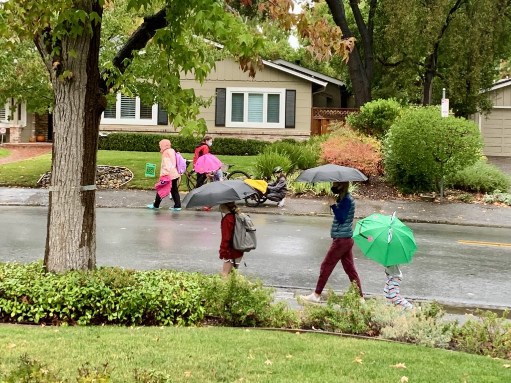 Umbrellas come out to start the school day in Menlo Park