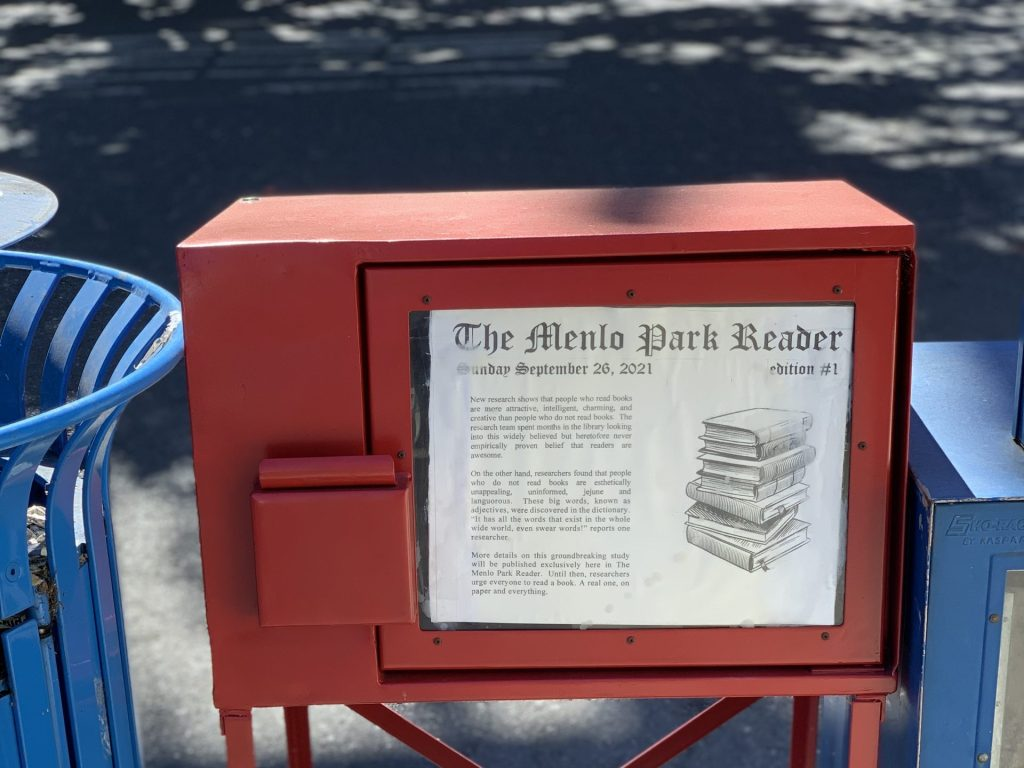 What is the big red newspaper box on the corner of Menalto and Gilbert?